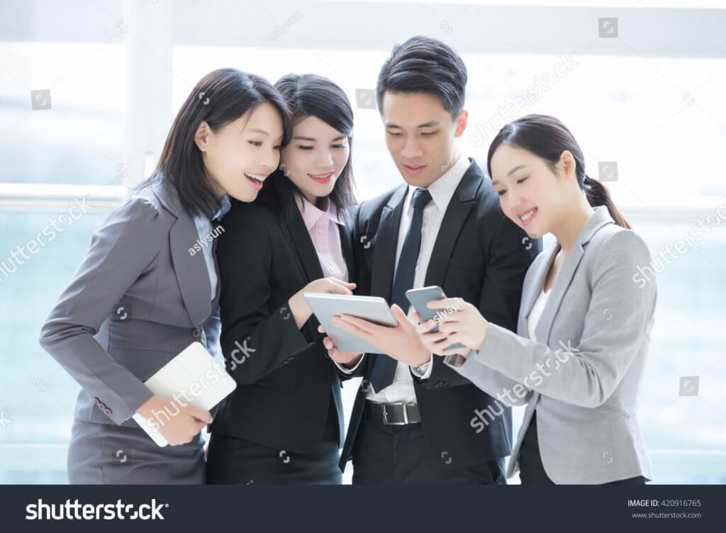 stock-photo-business-people-team-meeting-with-computer-in-the-office-shot-in-hong-kong-asian-woman-and-man-420916765